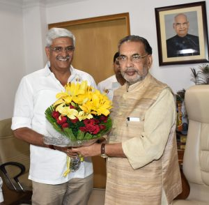 Union Minister for Agriculture and Farmers Welfare Radha Mohan Singh greeting new MoS Gajendra Singh Shekhawat